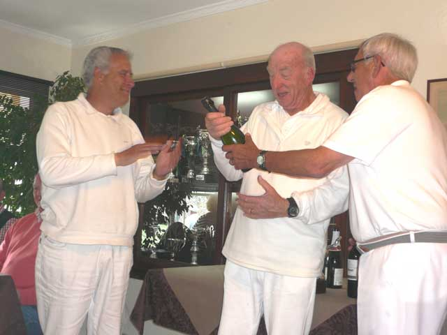 The two finalists receiving their wine at the lunch that followed the final